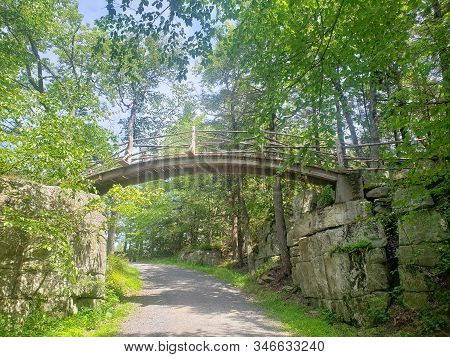 Bridge In The Woods Through A Hiking Trail In Upstate New York