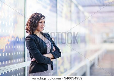 A shot of a African American businesswoman standing outdoor