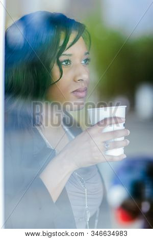 A shot of an African American businesswoman holding a cup of coffee for breakfast