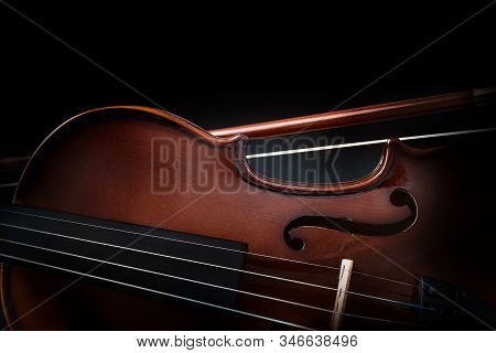Violin Detail With Bow And Isolated Black Background. Front View. Horizontal Composition.