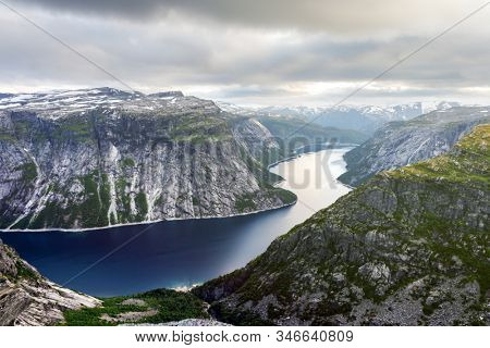 Breathtaking view on ringedalsvatnet lake from Trolltunga rock - most spectacular and famous scenic cliff in Norway. Landscape photography