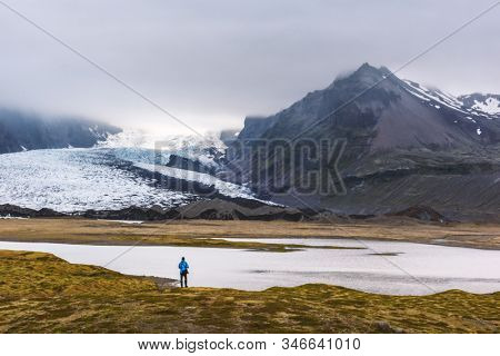 Lonely tourist near Vatnajokull glacial lagoon. Vatnajokull National Park, southeast Iceland, Europe. Landscape photography