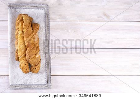 Homemade Freshly Baked Breadsticks With Puff Pastry Cheese On A Light Wooden Background, With Place