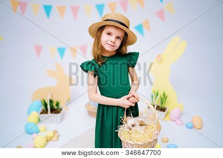 The Girl With The Rabbit. Happy Little Girl Holding Cute Fluffy Bunny. Friendship With Easter Bunny.