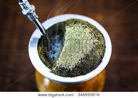 Yerba Mate Tea In Calabash On Wooden Table. Traditional Argentine, Uruguayan And Brazilian Drink. Ty