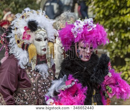 Annecy, France, February 24, 2013:  Portrait Of A Disguised Couple Posing In Annecy, France, During
