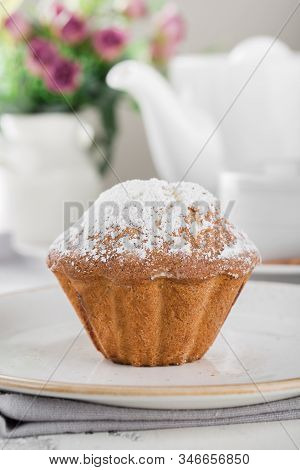 Morning Breakfast. Tasty Muffin Sprinkled With Icing Sugar On A Plate.