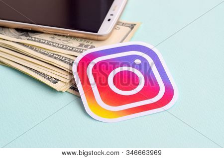 Instagram Paper Logo Lies With Envelope Full Of Dollar Bills And Smartphone