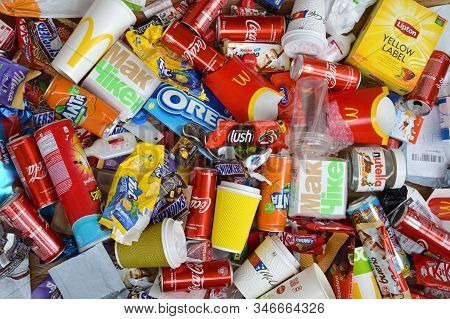Big Pile Of Many Disposable Colored Trash From Edible Products Of Famous Food And Beverage Manufactu
