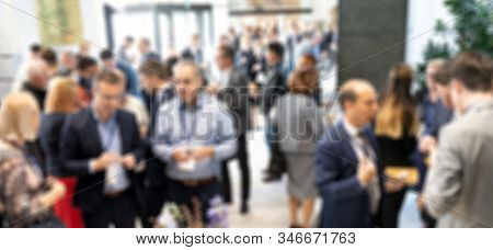 Abstract Blured Photo Of Business People Socializing During Banquet Lunch Break Break At Business Me