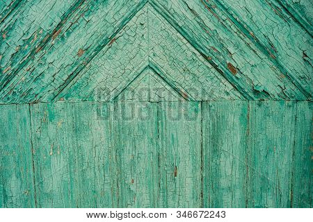 Wooden Surface With Crumbling Paint. Textured Background Of Old Lumber Surface With Crumbling Turquo