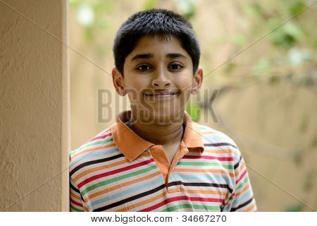 Handsome Indian toddler standing outdoor thinking poster