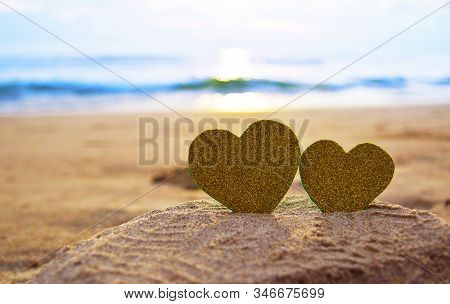 Happy Valentines Day, Valentines Day Background, Hand Holding Gold Heart Shape In Soft Focus Backgro