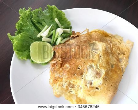 Traditional Thai Cuisine, Stir Fried Noodle Or Phad Thai Wrapped With Omelet