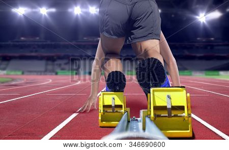 Sprinter Athlete Launching Off From The Start Line In A Race