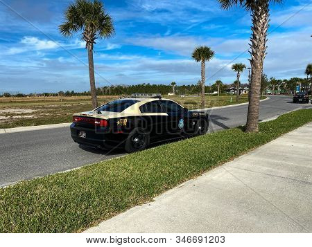 Orlando, Fl/usa-1/23/20: A Florida Highway Patrol Car Parked On A Neighborhood Street In Laureate Pa