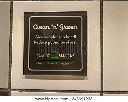 Orlando, Fl/usa-1/22/20: A Sign In A Shake Shack Fast Food Restaurant Bathroom That Encourages Peopl