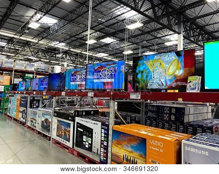 Orlando,fl/usa -1/23/20:  The Tv Aisle Of A Sams Club Wholesale Retail Store With A Variety Of Telev