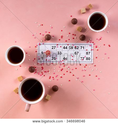 Lotto Ticket With Wood Barrel 14 Number And Coffee Tea Cups, Sweets Candy Chocolate On Pink Hearts B