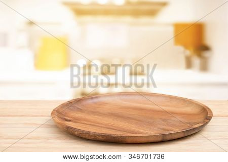 Empty Wooden Tray On Perspective Wooden Table On Top Over Blur Flower Background. Can Be Used Mock U