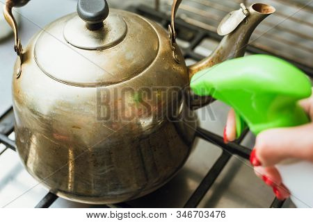 Descale And Grease A Metal Kettle With A Cleaning Agent In The Kitchen.