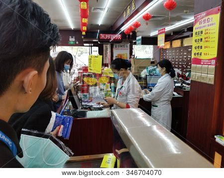 Zhongshan China-january 24,2020:people Buying Masks In A Drug Store.everyone Is Protecting Himself T
