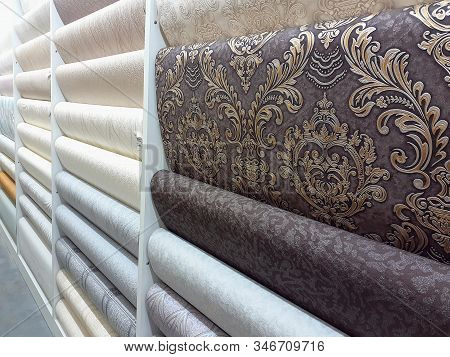 Shop Window With Wallpaper. Large Selection Of Wallpapers For Home On A Rack In A Store For Repair