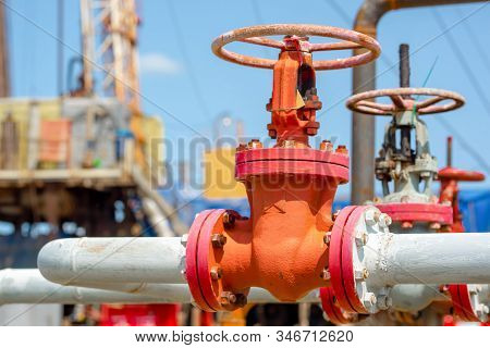 Oil And Gas Processing Plant With Pipe Line Valves. Industrial Zone, Steel Pipelines And Valves Blue