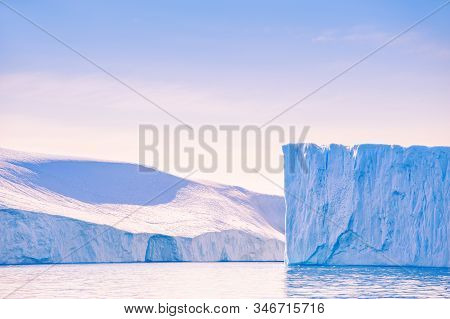 Big Icebergs At Sunset In The Ilulissat Icefjord, West Coast Of Greenland