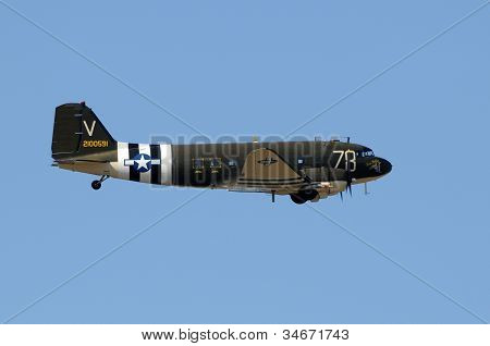 Old DC-3 Propeller Airplane In Flight