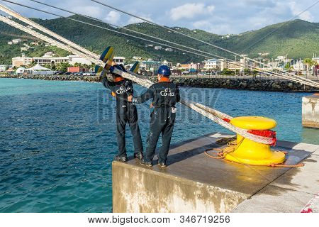 Road Town, Tortola, Bvi - December 16, 2018: On The Mooring Platform A Workers Put Marine Rat Guard
