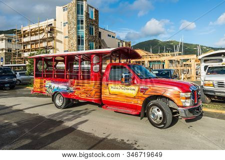 Road Town, Tortola, Bvi - December 16, 2018: The Colorful Tour Bus Pirates Of The Caribbean Waiting