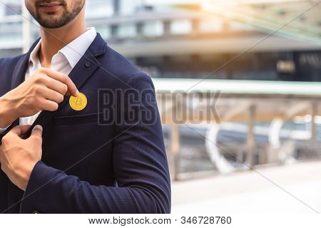 White Collar Worker Put Bitcoin To Suit Pocket Or Young Business Man Pick Bitcoin From Suit Pocket.