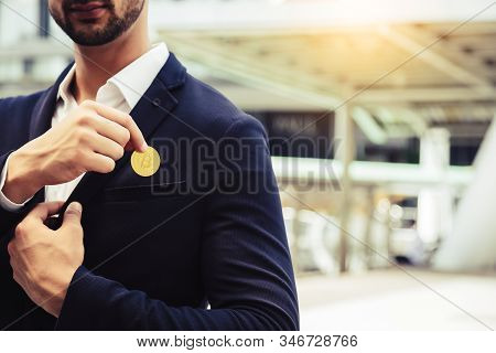 Investor Beard Guy Showing Bitcoin In A City. White Collar Worker Put Bitcoin To Suit Pocket. Young