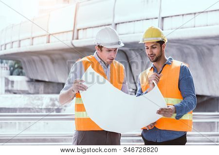 Engineer Boss And Foreman Or Worker Working Together At Worksite In City. Employer Guy Explaining Pr