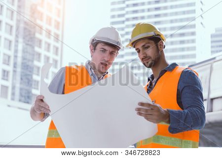 Engineer Boss And Engineer Worker Collaborate, Working Together At Worksite. Employer Guy Explain Pr