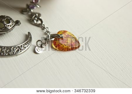 Amber Heart Pendant, Jewelry, Jewelry Lies On A White Wooden Table, Copyspace
