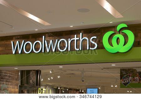Brisbane, Queensland, Australia - 21st January 2020 : Illuminated Woolworths Sign Hanging In Front O