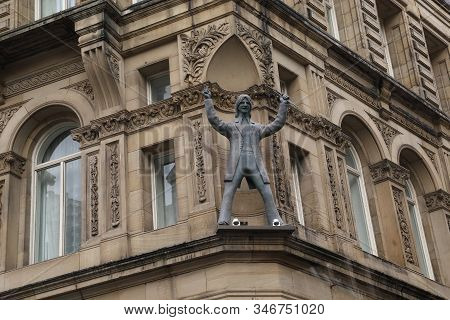 Liverpool, Great Britain - September 13, 2014: This Is A Sculpture Of Ringo Starr On The Eaves Of On