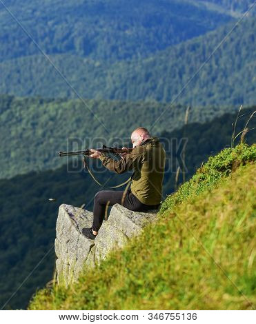 Hunter Hold Rifle. Hunter Spend Leisure Hunting. Hunting In Mountains. Man Brutal Gamekeeper Nature