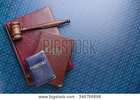Judge's Gavel, Books And Passport On Table. Immigration Law Concept