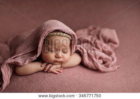 Portrait Lovely Newborn Baby Girl Lying Down On A Blanket.
