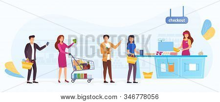 Queue Of Shoppers In A Supermarket, Waiting To Pay For Their Groceries At The Cashier With Baskets A