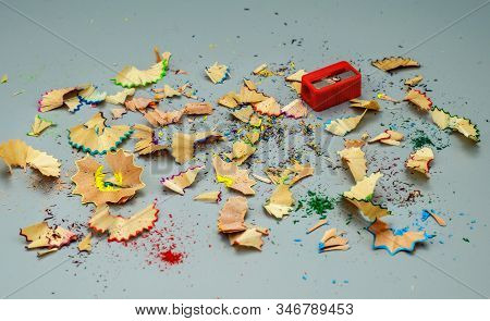 Wooden Shavings With Pencils And Sharpening On A Gray Background