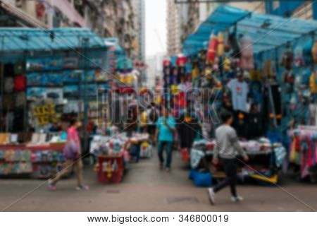 Abstract, Blurry  Image Of People On Street Market (ladie`s Market) In Hong Kong