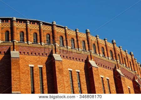 Exterior View Of An Old Red Brick Gas Holder Building.