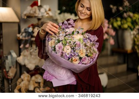 Well Dressed Female Looking At Flower Bouquet