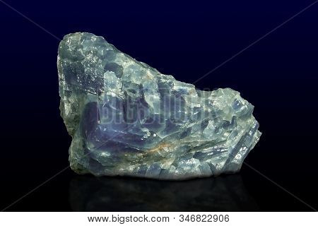 Rock Of Blue Calcite Mineral On Dark Background.