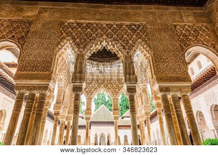 GRANADA, SPAIN - December 11 2019: Architecture Details of the Palace of the Alhambra in Grenada, Spain with columns, arches and fine arabic style carvings