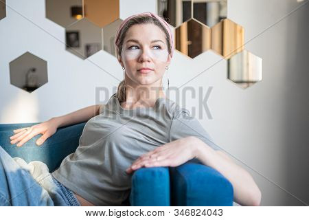 Young Attractive Woman With Eyepatches Making Face Care Morning Routine